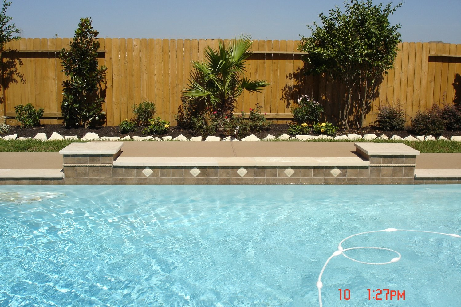Spring pool designs tomball katy kingwood cypress for Pool design katy